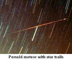 Perseid meteor with star trails